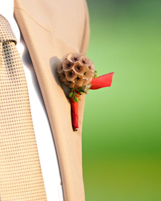 POWER OF A LITTLE FLOWER: An eye-catching boutonniere complemented Moyer's poplin suit from Joseph A. Banks.