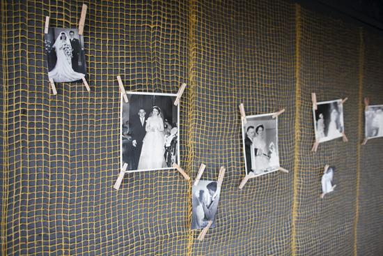 PINTEREST: Sara and Josh clothes-pinned family photos on netting they hung on the walls of the picnic shelter where they hosted a reception.