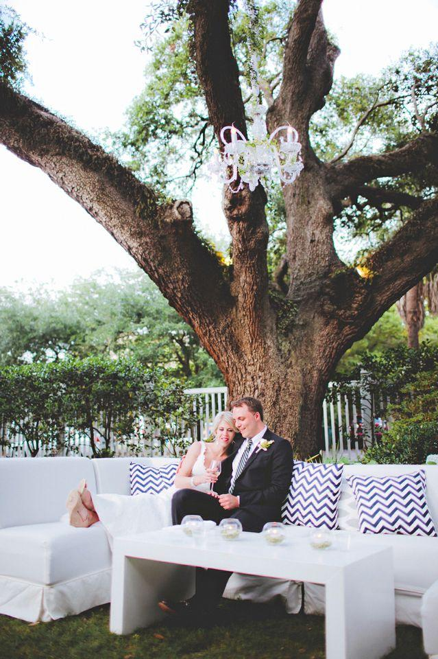 GET COZY: A good friend of the couple's made the reception's throw pillows, which now adorn their newlywed nest.