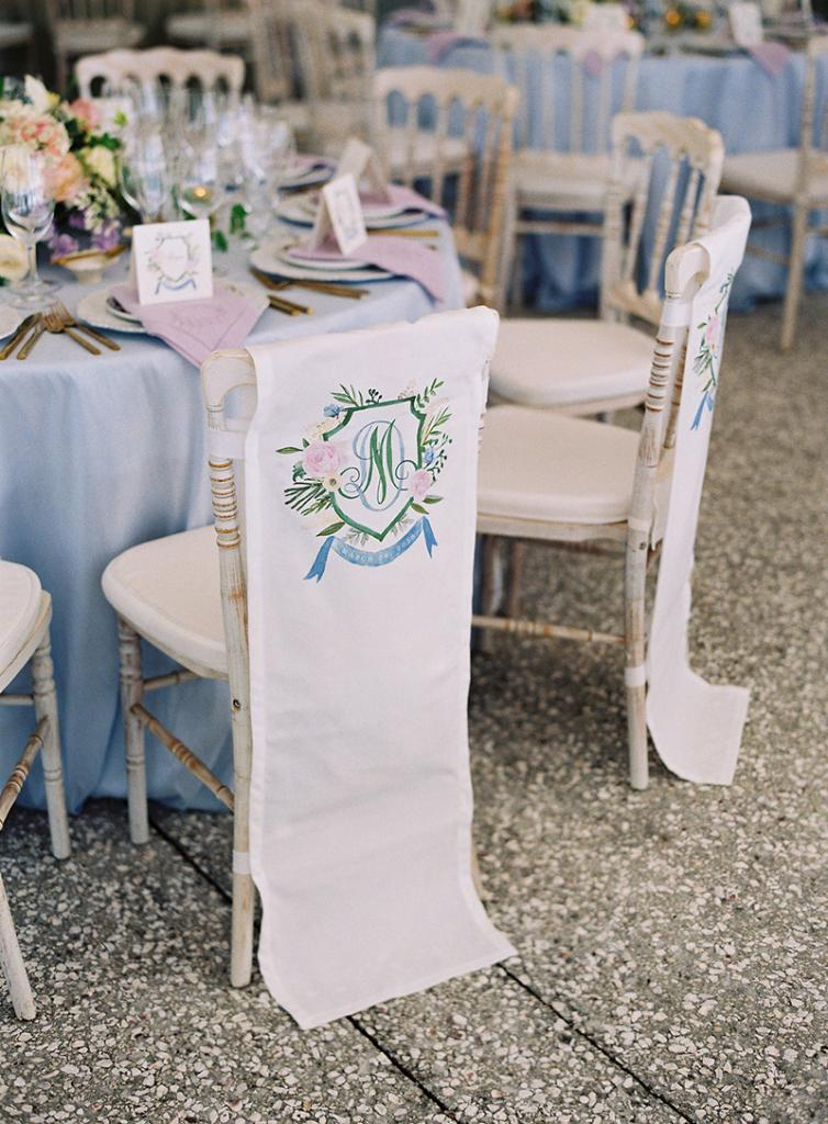 """People forget how much can be digitized these days,"" says Calder, explaining you can purchase chair adornments like these online, and take them, along with a scan of your wedding crest or monogram, to a local screen printer."