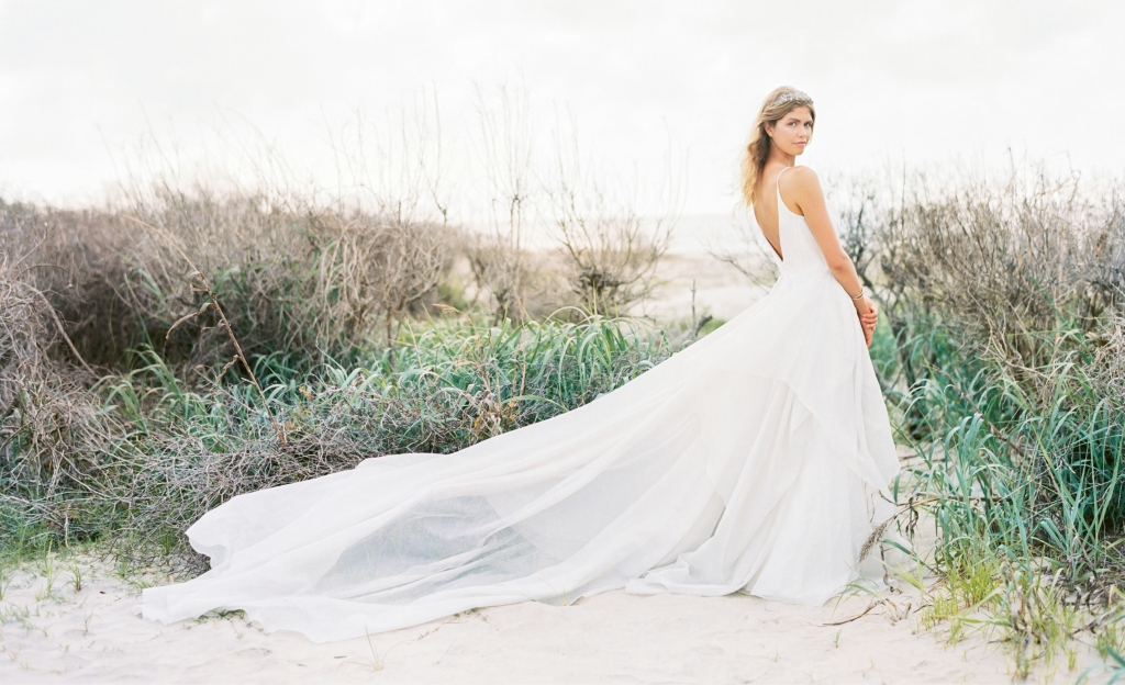 "Carol Hannah's ""Lutosa"" metallic silver gown from Southern Protocol Bridal. ""Andes"" smoky quartz crown by Emma Katzka. Hammered cuff from Out of Hand. Location: Seabrook Island, Beach Access 6. Photograph by Perry Vaile"