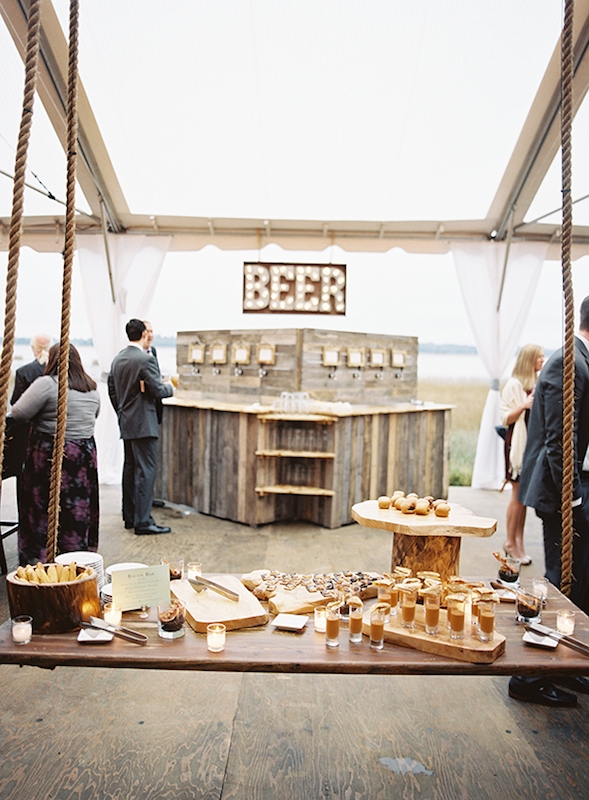"Many elements were riffs off the bride's restaurant, Bay Street Biergarten, like this ""beer wall,"" which, Laura says, gave guests more brew options than standard bar service generally affords. Catering by Patrick Properties Hospitality Group. Image by Virgil Bunao Photography at Lowndes Grove Plantation."