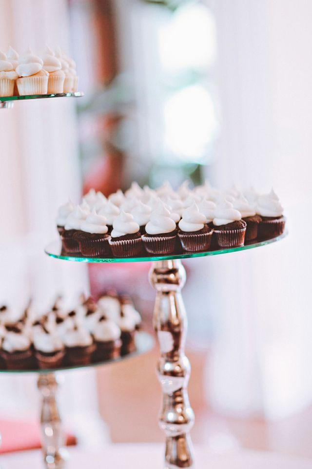 TAILORED TREATS: In lieu of a tiered confection, the King Street bakery Cupcake provided mini cupcakes for the dessert spread.