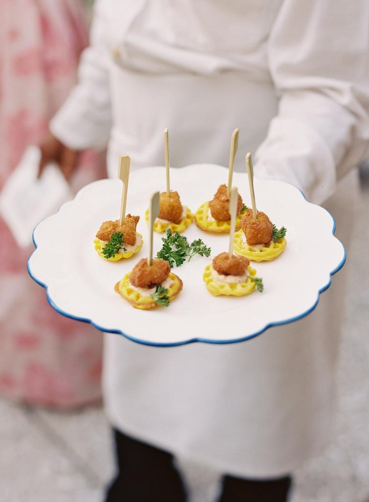 """The serving plates echoed the scalloped motif on the cake. """"I love a good scallop,"""" laughs Calder."""