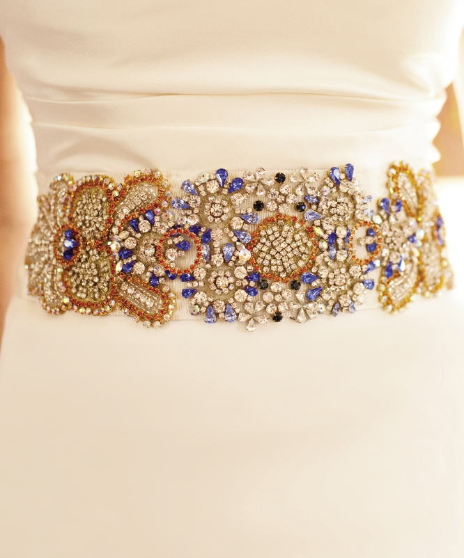"CROWN JEWELS: Jessica says she wanted to ""add a little color and some spunk"" to her ensemble, so she commissioned a handcrafted,  bejeweled sash from the Etsy shop Doloris Petunia to accent  her Vera Wang gown."
