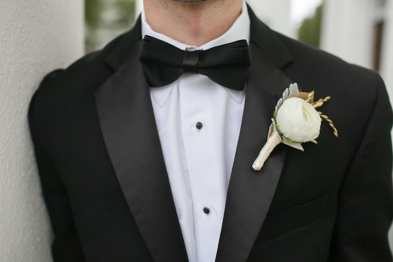 Groom's attire from Berlin's. Boutonniere by Charleston Stems. Image by The Connellys.