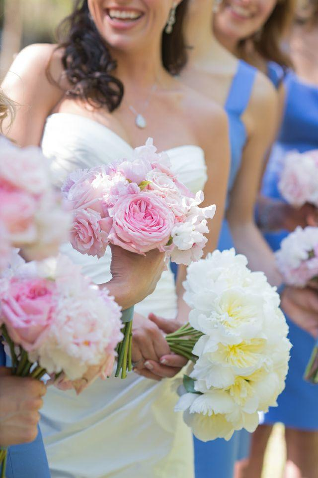 "FOLLOW YOUR HEART: Dressed in a Romona Keveza gown, D'Anne wore a necklace of diamonds passed down from her grandmother Ma, whose wise words (""Love isn't convenient; you have to go where your heart is"") finally convinced D'Anne to follow after Patrick. Charleston florist stems arranged bouquets of white and pink peonies for the bride and bridesmaids."