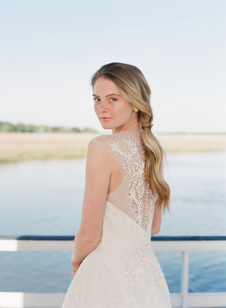 "Sabrina Dahan's ""Marion"" beaded and lace gown from Betty Bridal Atelier. Gold earrings from Paulo Geiss Jewelers"