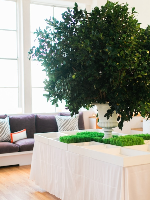 For a mega centerpiece, Tara Guérard Soirée placed leafy boughs in floral foam anchored in a heavy urn.