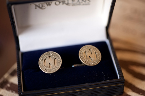 "REMEMBER WHEN: Chloe gifted Paul a pair of antique cufflinks made from New Orleans streetcar tokens dated back to 1919. Though they met in Charleston, the couple reconnected and began dating while on a visit to New Orleans. Chloe says, ""I wanted to find a way to represent New Orleans on our wedding day, and I thought this gift combined Paul's love for historic, unique items, his love for New Orleans, and the importance of the city in our relationship."""