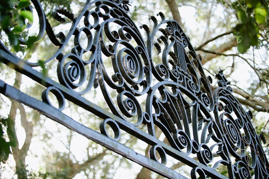 "A SENSE OF PLACE: Lowndes Grove's wrought iron gate—a common sight throughout the Holy City—added to the ""quintessentially Charleston"" look Chloe wanted."