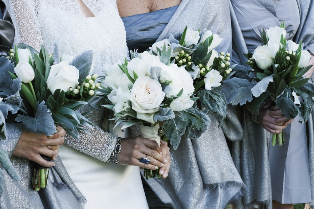 SILVER BELLES: Chloe asked bridesmaids to wear a silver or gray dress of their choosing and gifted each of them a silver wrap to keep warm and to tie their varied looks together.