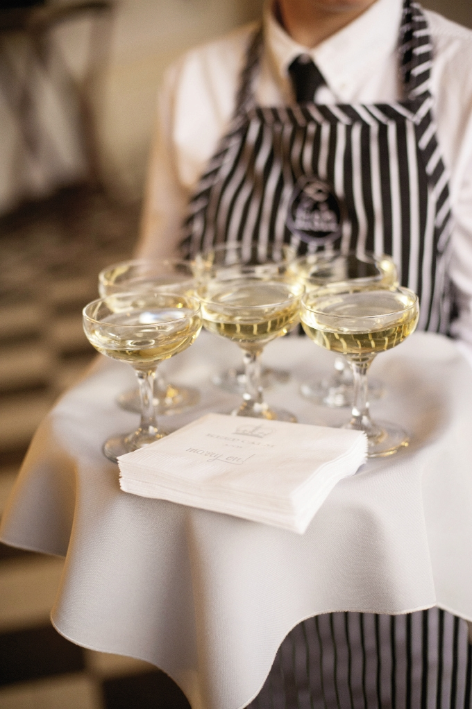 CHEERS! Guests toasted the newlyweds—and rang in the New Year—with champagne coupes, considered fashionable in the 1930s.