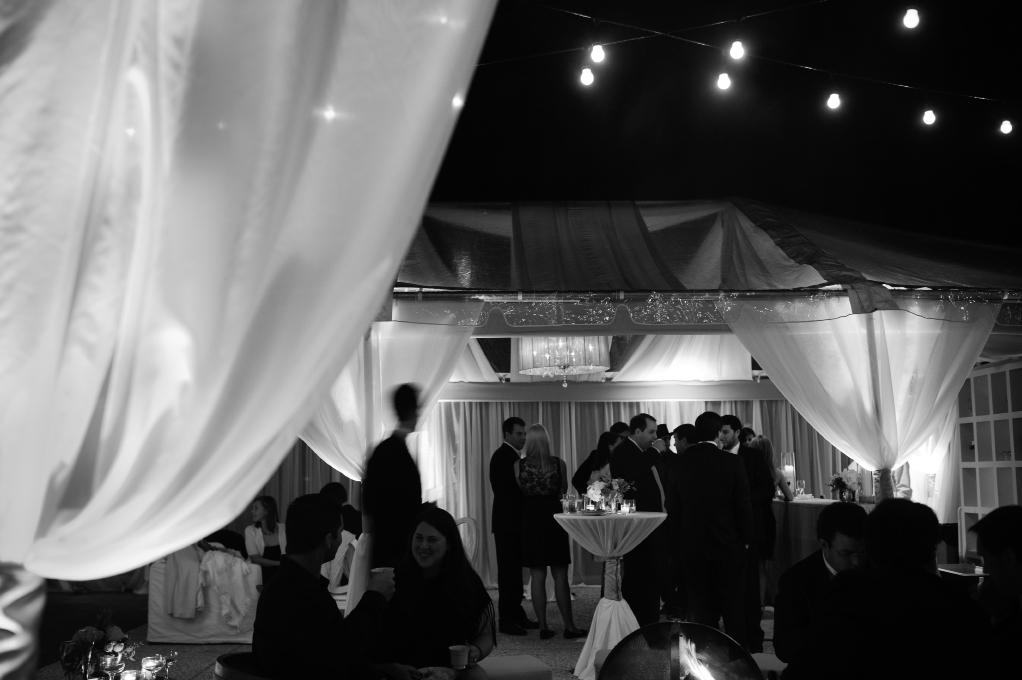 UNDER THE STARS: Charleston's mild weather allowed guests to mingle either in the tent or al fresco.