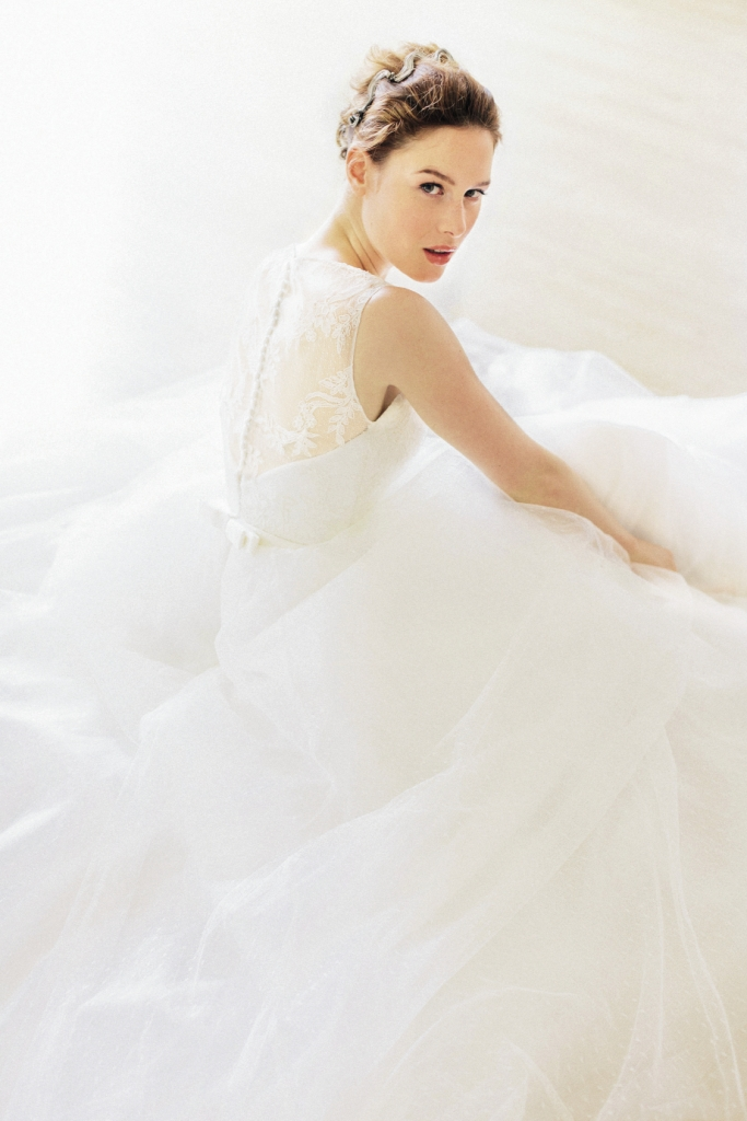 TULLE MUCH: Legends by Romona Keveza's point d'esprit lace gown from  Maddison Row. Colette Malouf's headband from Swoon.