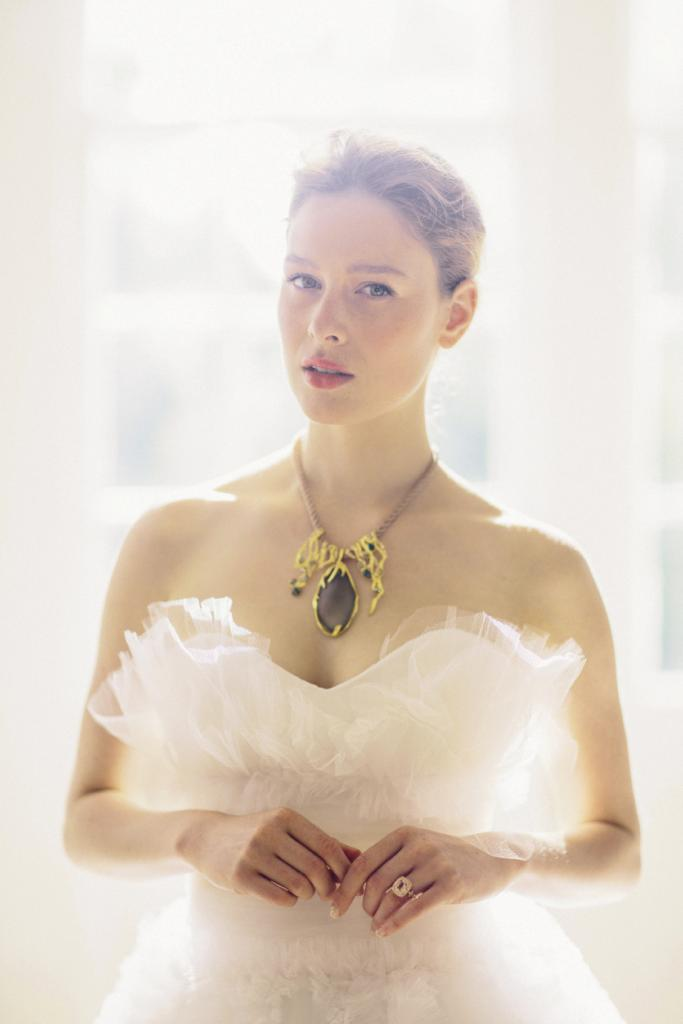 ETHEREAL MOMENTS: Alexis Bittar's silk necklace with Lucite pendant from Gwynn's of Mt. Pleasant. 18K rose gold ring with morganite and diamonds from Croghan's Jewel Box. Marchesa's ruffled and tiered tulle gown from White on Daniel Island.