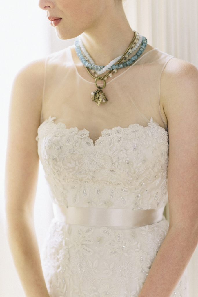 "GENTLE REPOSE: Bittersweet Designs' bead and chain  necklace with charms from Out of Hand. Watters' ""Mollie""  embroidered and beaded lace and organza gown with illusion upper, available through Bridals by Jodi, Jean's Bridal, and White on Daniel Island."