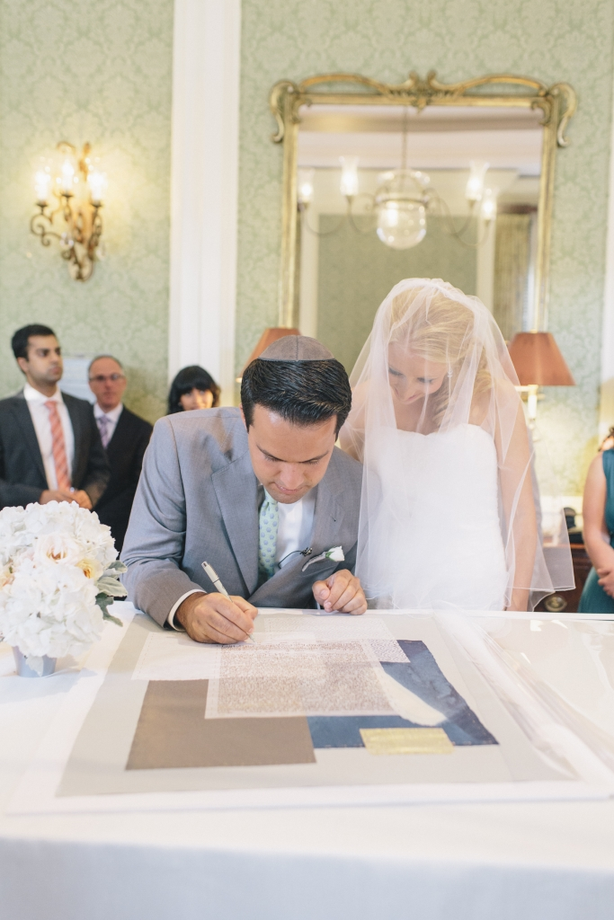 ON THE DOTTED LINE: In keeping with Jewish tradition, Ezra signed a ketubah (or marriage contract) prior to the ceremony, signifying his promise to provide for his bride-to-be.
