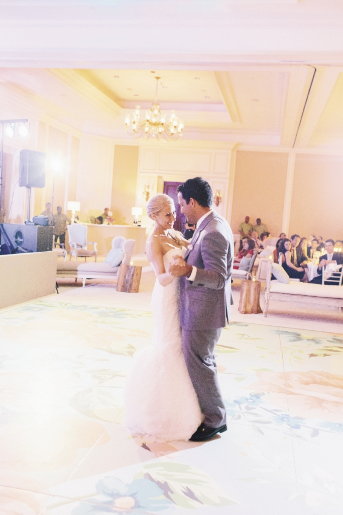 "BIG IMPACT: Tara gifted the couple with a surprise: a dance floor covered with the patterns from the wedding stationery and the colors of the weekend. ""It drew in all of our guests,"" says Diana, ""I've never been to another wedding where people stayed on the dance floor all night long!"" The look was achieved with a large-scale, custom-made decal."