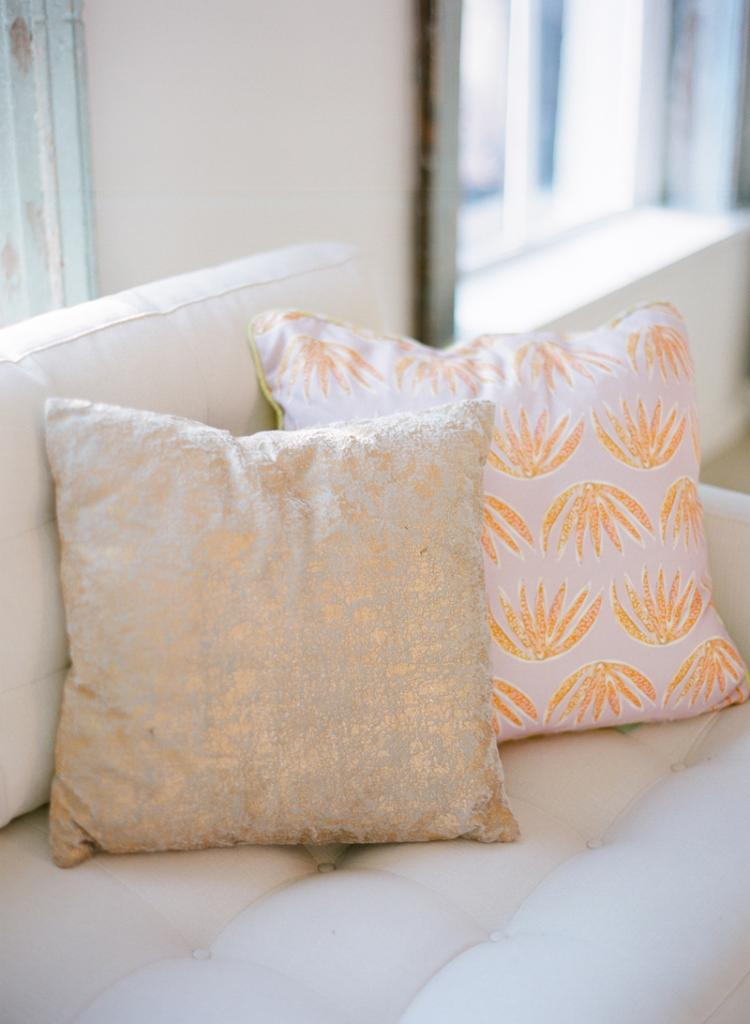 GET COZY: Pillows donned cheery fabrics designed by Lulie Wallace and added comfort to seats throughout the LulaKate atelier.