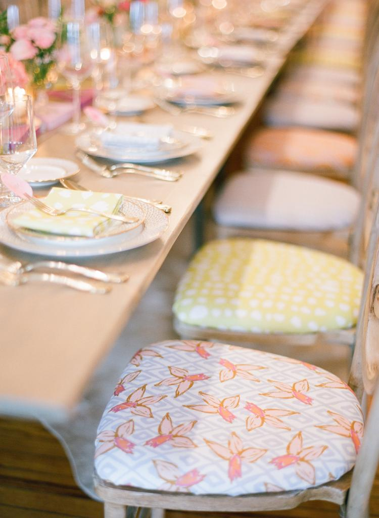RAINBOW SET: Covering chair seats in a selection of fabrics added depth to the décor.