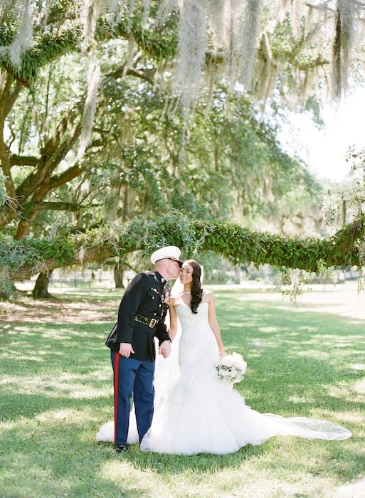 Gown by Mark Zunino. Florals by Charleston Stems. Image by KT Merry Photography at Middleton Place.
