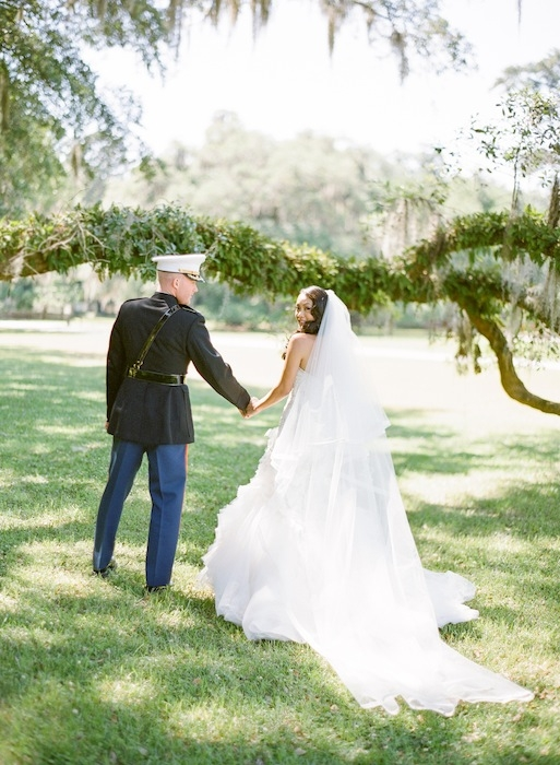 Gown by Mark Zunino. Veil by Pnina Tornai. Image by KT Merry Photography at Middleton Place.