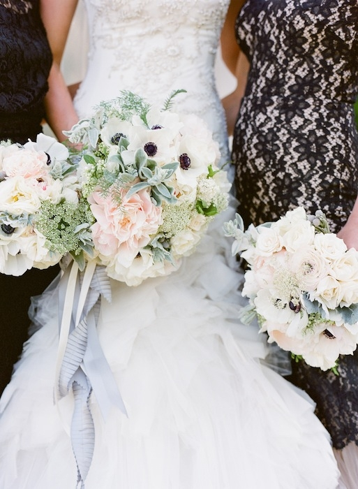 Bouquets by Charleston Stems. Gown by Mark Zunino. Bridesmaid attire from Rent the Runway. Image by KT Merry Photography.