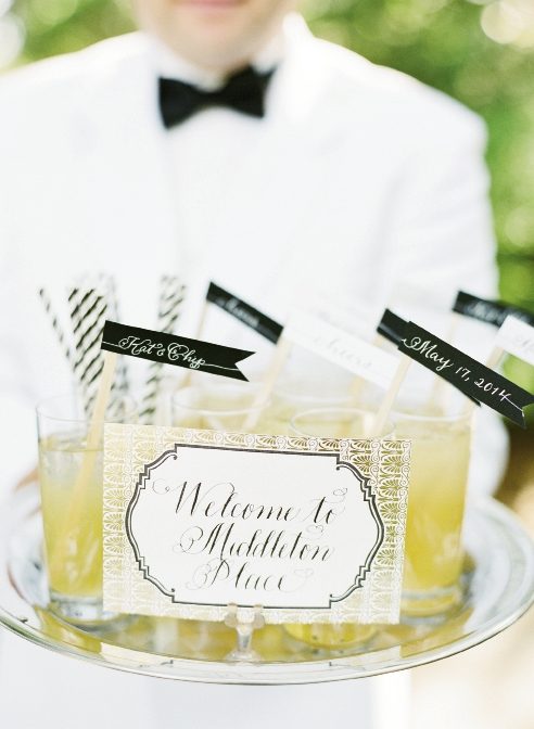 """X"" MARKS THE SPOT: Upon arrival, guests were met with drinks  sporting handmade swizzle sticks and a custom map to guide them through the gardens to the ceremony, cocktail hour, and reception sites."