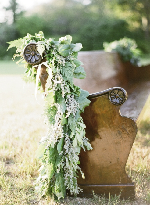 NEAT SEATS: Charleston Stems dressed up seating from P.E.W.S. with beribboned greenery garlands.