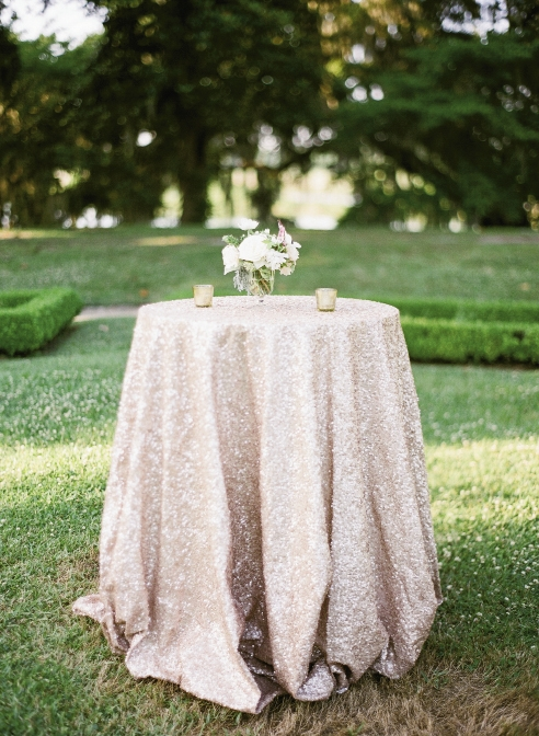PRETTY IN PINK: Cocktail tables in Middleton's Octagonal Garden shimmered in  sequin-covered rose-gold La Tavola linens.