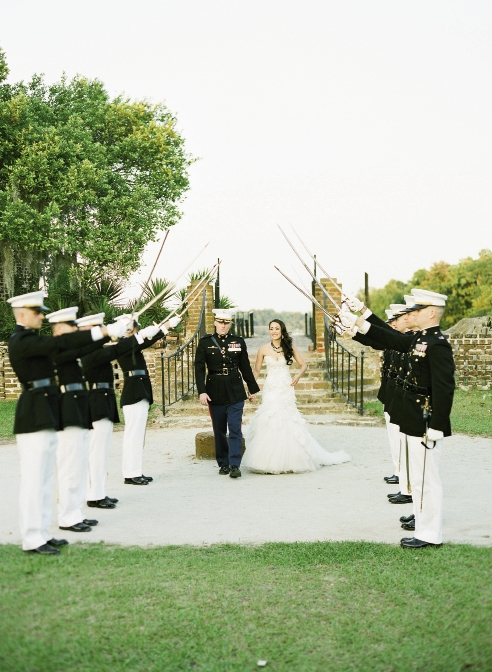 "GOOD OL' BOY: After the couple passed beneath the official Arch  of Swords, Maj. Chip's  former roommate Capt. Kyle ""DWIMM"" Reilly customarily slapped the bride on the backside with the unofficial comment, ""Welcome to the Marine Corps, ma'am!"""