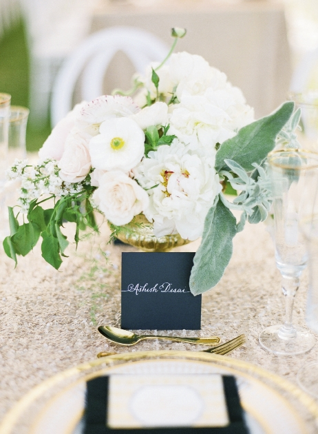 Florals by Charleston Stems. Linens from La Tavola. Place cards by Laura Hooper Calligraphy. Image by KT Merry Photography.