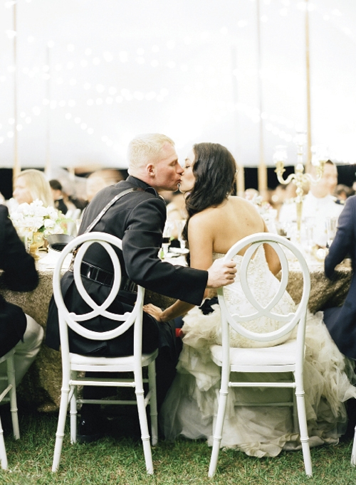 LOVE ETERNAL: The couple sat in EventHaus' Infinity chairs placed at the center of a kings' table alongside their parents, the wedding party, and more. They loved the party-watching vantage it afforded, says Kat.