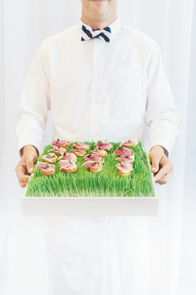 Small bites were displayed in custom-made boxes that doubled as trays. Here, rainbow radishes sit atop whipped ricotta and crostini. (this page, bottom left) Soirée incorporated a touch of the Hamptons (Annie's wish) with boxwood hedges.