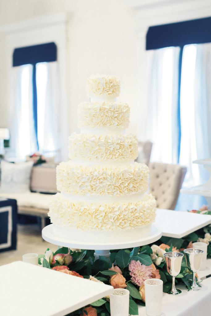 "Annie admits to being obsessed with ""clean-lined"" design, so a classic white-on-white cake fit the bill."