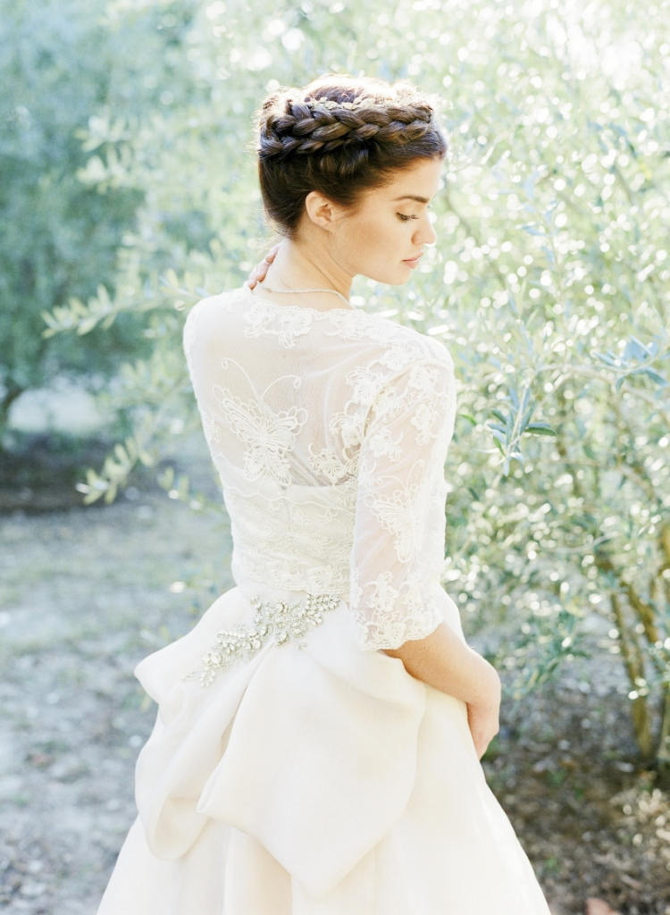 "MONARCH BUTTERFLY: Monique Lhuillier's ""Ribbon"" gown in blush silk with back bow and crystal details from Maddison Row. Antique lace bolero with three-quarter-length sleeves from Bridal House  of Charleston. Jane Tran's crystal, pearl, and silver leaf headband from Swoon."