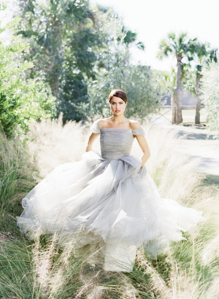 """ROYAL SOCIETY: Sareh Nouri's """"Marie Antoinette"""" grey tulle gown with cap sleeves and organza and tulle floral back detail from Maddison Row. Vintage drop earrings from Charleston Fynd."""