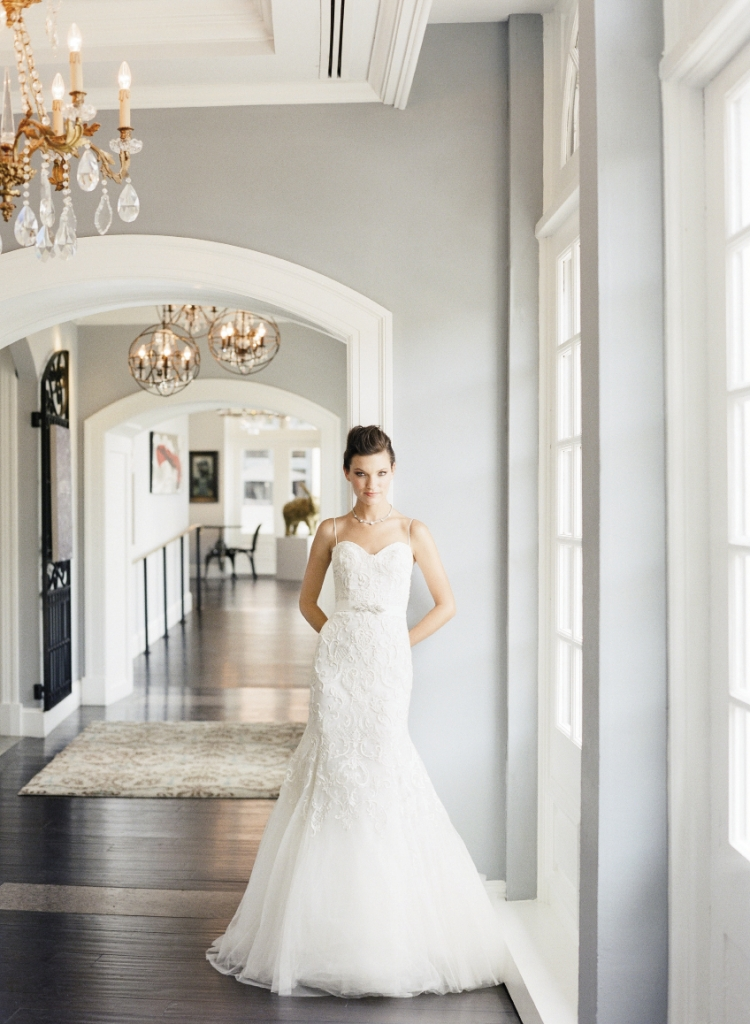 "Monique Lhuillier's ""Emmeline"" trumpet gown with baroque embroidered tulle  from Maddison Row. LOVE's embellished sash from Gown  Boutique of Charleston. White gold and  diamond necklace from Croghan's Jewel Box. Image by Corbin Gurkin, photographed at The Vendue."