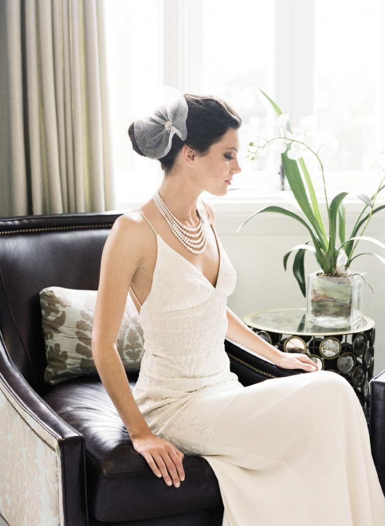 "Nicole Miller's ""Annabelle"" baroque silk beaded gown from Southern Protocol Boutique. Tulle and rhinestone hair clip from White on Daniel Island. Lorren Bell's pearl and Swarovski crystal art deco necklace from Gwynn's of Mount Pleasant. Image by Corbin Gurkin, photographed at The Vendue."