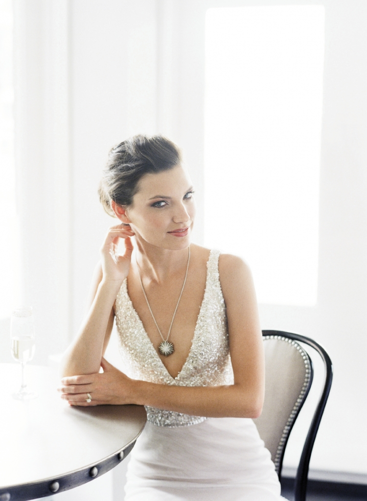 Jim Hjelm's gown with sequin bodice and netting from Gown Boutique of Charleston. David Yurman's sterling silver and diamond pendant necklace from REEDS Jewelers. Yellow gold diamond ring from Joint Venture Estate Jewelers. Image by Corbin Gurkin, photographed at The Vendue.