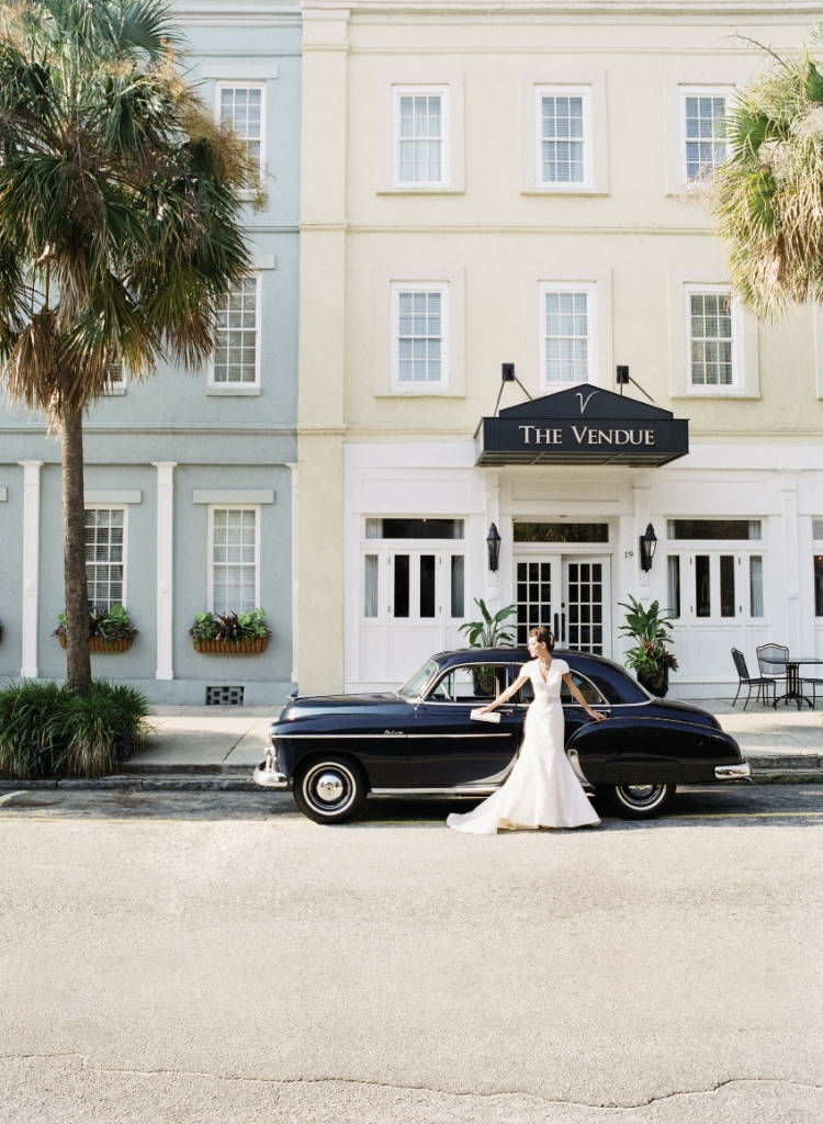 Justin Alexander's silk dupioni cap-sleeved gown with pearl and crystal waistband from Bridal House of Charleston. 1950 Chevrolet Bel Air Deluxe car from Lowcountry Valet & Shuttle Co. Image by Corbin Gurkin, photographed at The Vendue.