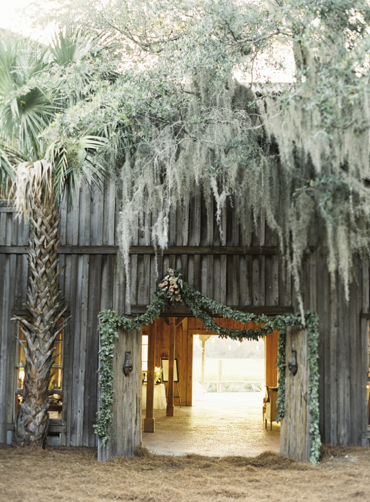 HANGING OUT: Heather Barrie of Gathering Floral + Event Design draped the entrance to the Cotton Dock at Boone Hall Plantation with garlands of seeded eucalyptus.