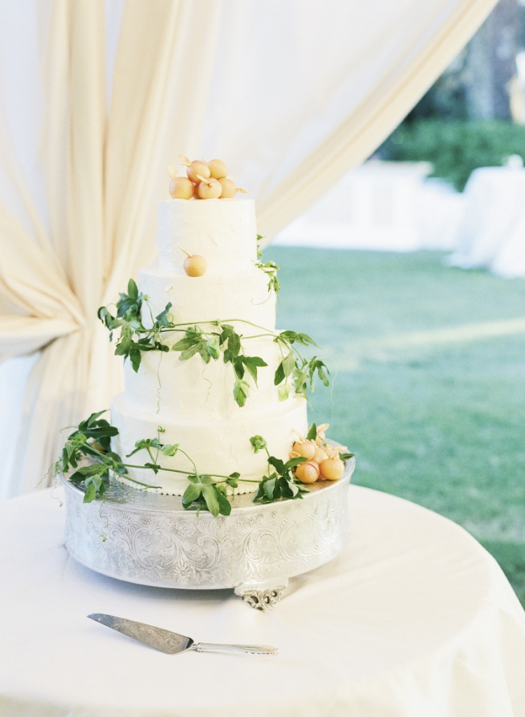 Marzipan fruit spilled over the four-tiered dessert finale. The bride's favorite flavors? Layers of almond cake with lemon curd filling.
