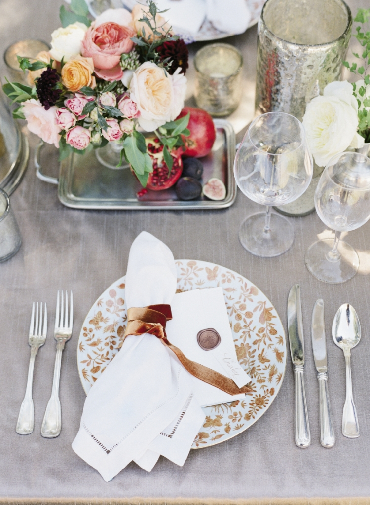 The Sacred Bird and Butterfly pattern was first noted in Charleston in 1808 at the Nathaniel Russell House; Yeamans Hall Club serves on reproductions of the china. Martha gathered luxe velvet ribbon in the same rusty hue to bind napkins.