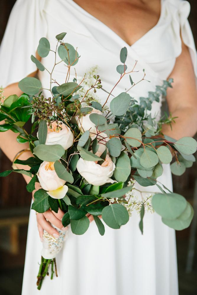 Florals by bride and friends. Image by Susan Dean Photography at Bowens Island Restaurant.