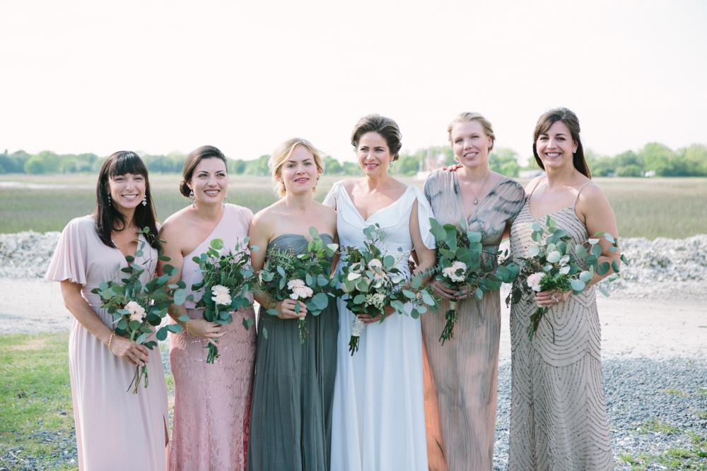 Bridesmaids' dresses from personal wardrobes. Bride's gown from her mother, altered by Jean's Bridal. Bouquets by bride and friends. Hair by Patrick Navarro. Makeup by Madison Hughes Makeup.  Image by Susan Dean Photography at Bowens Island Restaurant.