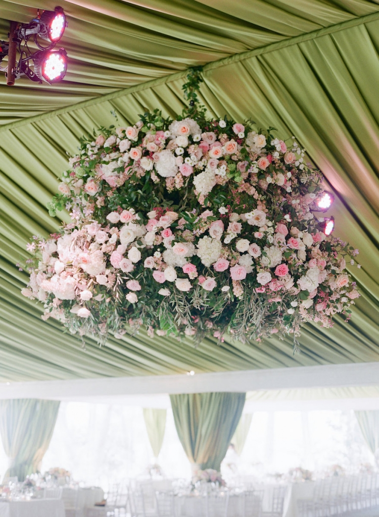 Photograph by Corbin Gurkin. Design by Easton Events. Draping and florals by Blossoms Events. Lighting by Technical Event Company.