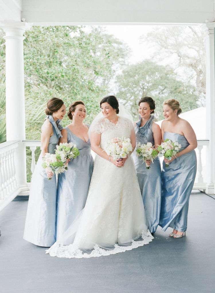 Photograph by Corbin Gurkin. Bride's attire by Oscar de la Renta. Bridesmaids' attire by LulaKate. Bouquets by Blossoms Events.