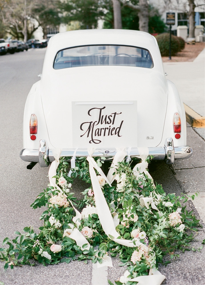 Photograph by Corbin Gurkin. Florals by Blossoms Events. Getaway car by Charleston Style Limo.